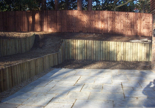 Log Retaining Wall & Close Board Fence