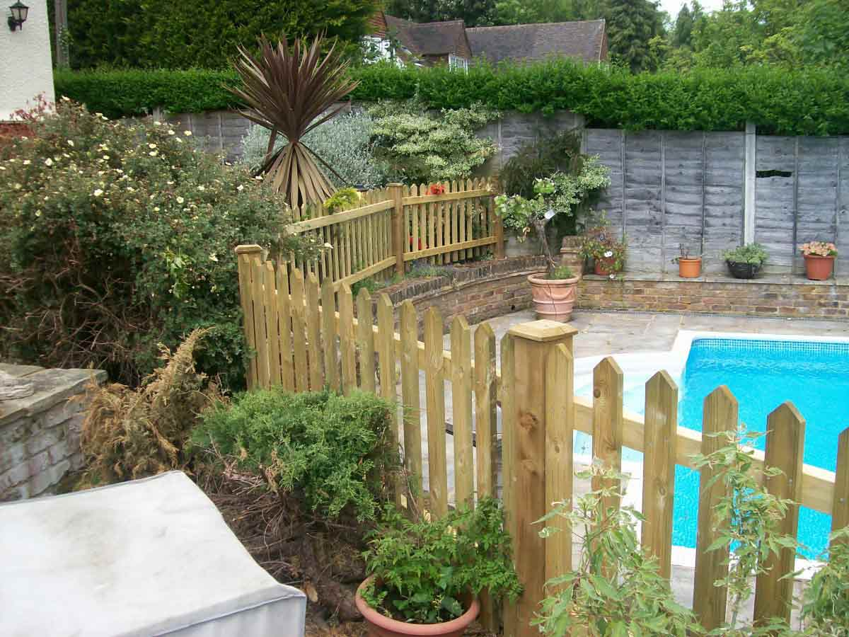 Picket Fence Around Swimming Pool. View Image Larger
